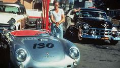 "James Dean stands with his allegedly haunted Porsche, which he only owned for 9 days, before his death. Many blame the car, ""Little Bastard."""
