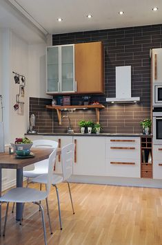 would totally settle for a small kitchen if it looked like this! love the butcher's block table