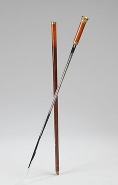 "1875-1900 Spanish Cane at the Metropolitan Museum of Art, New York - From the curators' comments: ""This gentleman's novelty cane conceals an elaborately engraved and monogrammed sword blade. While technically functional as a sword, the absence of a proper grip and guard make the cane more suited to braggadocio than actual dueling."""