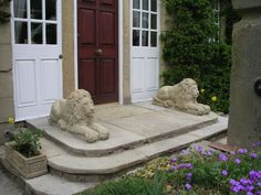 Sand #stone #sculpture by #sculptor Martyn Bednarczuk titled: '2 carved Lions (Pair Front Doorstep Resting Carved stone statues)'. #MartynBednarczuk