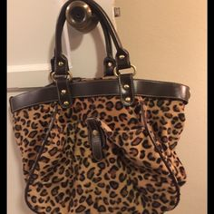 Cute Leopard Purse Great leopard purse to jazz up an outfit. No label. Great shape. Brown faux leather accents with gold hardware. Comes with detachable leather strap that's not used. Nothing says style like an animal print. Grrrrrrrr  Bags Shoulder Bags