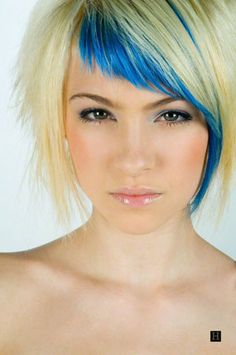 woman with a short hairstyle and blonde and blue hair color