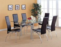 "5 Piece Pearl silver Dining Set by Coaster Home Furnishings. $913.38. Some assembly may be required. Please see product details.. Pearl silver dining table with two 12"" pull out extensions. Extensions at each end of the table pull out to 72"". Dine in the executive way and reflect upon the days. Chairs finished in silver with elegant black bonded leather seat and back. Add Server(7643) with frosted glass doors to compliment set.. Save 46%!"