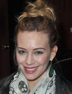 Hilary Duff's tousled updo is the perfect hairstyle for an outdoor springtime soiree. Simply gather your hair into a loose high ponytail and secure it with an elastic. Then, pin different-sized sections of your ponytail in loops going in opposite directions around the root of the ponytail. Pin the ends into place. Voilà, an updo!