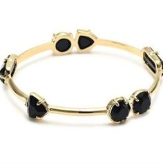 "kate spade desert stone bangle. Price firm. Scattered black jewels bring color to a shiny gold-plated bangle. Includes dust bag. Approx. inner circumference: 8"". Approx width 1/8"". kate spade Jewelry Bracelets"