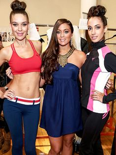 SAMMI GIANCOLA and two models modeling Sammi's new SXE fitness clothing line.