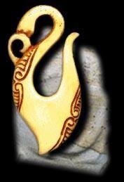 Maori bone carved necklace charm.