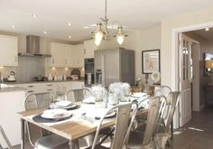 David Wilson Homes does a modern take on the French Kitchen / Dining Room - using industrial metal chairs and metal light fitting.