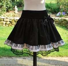 Piano keyborad musical notes skirt....would be a good idea for a cute apron!