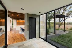 Image 24 of 39 from gallery of Woodland House / ALTUS Architecture + Design. Photograph by ALTUS Architecture + Design Modern Glass House, Glass House Design, Minnesota Home, Minneapolis Minnesota, Cedar Walls, Pergola, Woodland House, Contemporary Style Homes, Commercial Architecture