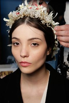 Models prepare backstage at the Reem Acra Fall 2015 Bridal Collection show at the Reem Acra Boutique on October 10, 2014 in New York City.