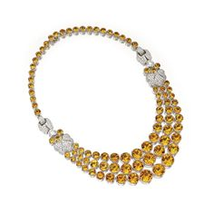 CITRINE QUARTZ AND DIAMOND NECKLACE. The front designed as three graduated rows of round citrines, the sides accented with foliate motifs and buckles pavé-set with small round diamonds weighing approximately 6.10 carats, further set with  2 round diamonds together weighing approximately 3.15 carats, mounted in 18 karat white gold