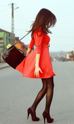 Black tights, black shoes, black bag, and red dress