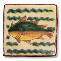 <h3>This Sicilian tile depicts a fish.</h3><br /> <p>The tile is entirely handmade and hand painted in Caltagirone by Giacomo Alessi, one of the most relevant ceramic artists in Italy. <br />Gracefully hand painted with traditional Sicilian subjects, the tiles made by Giacomo Alessi have that particular, witty simplicity that is quintessentially Sicilian. For his Collection 1800 Alessi draws inspiration from the subjects of the pottery made in Caltagirone in the 19th century.</p>