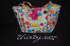 Try this awesome Tote-ally Awesome Tote!!  Item #3509 just $56!! Pair it with a scarf and you will have a roomy and stylish bag!    www.mythirtyone.com/taneshaj