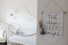 Leo's Sweet & Serene Nursery | embroidered banner with yarn tassels