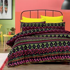 Bright hues continue with Zuma from Lorraine Lea, a tribal print that features brilliant neon colours on a contrasting black background. A modern design that will make a daring bedroom statement. The quilt cover has press stud closure. Available to order from 20 October 2014.