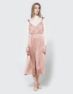 Lightweight slip dress from Farrow in Rose. V-neckline. Stitch detailing and removable tie at bust. Deep slit at front. Unlined.  • Charmeuse • 100% polyester • Dry clean