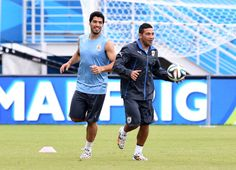 Luis Suarez and Walter Gargano of Uruguay during a training session.