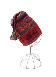 79a7e4c3d43 The traditional Peruvian cap is handknit in whimsical alpacas and dotted  bands of pink