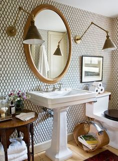 I don't love everything about this bath, but i do love the pedestal sink, wall paper chunky baseboard, wood floors and toilet seat and the warm and white color scheme