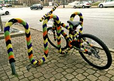 Bicycle Street Art in Downtown Kent, Ohio, a knitted bicycle rack and bicycle ready for a Northeast Ohio winter!