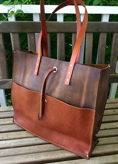 """Mixed Leather Tote 16"""" Wide 12"""" Tall 4.5"""" Deep 11""""-12"""" Drop We think this is one of our funnest bags. We love being able to mix and match the large front pocket on this tote. The bag affords plenty of space for just about anything you would need, the large front pocket can change"""
