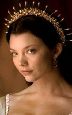 Natalie Dormer as Anne Boleyn on The Tudors.  Her headpieces were BEAUTIFUL in this series.