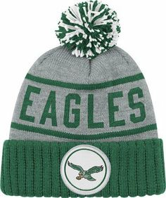 """Philadelphia Eagles Mitchell & Ness NFL """"The High 5"""" Vintage Cuffed Premium Knit Hat w/ Pom by Mitchell & Ness. $24.00. Cotton yarn embroidered team logo. Premium knit cap. Manufactured by Mitchell and Ness. Officially licensed. 100% acrylic. Protect your head and ears in the cold, blustery weather by wearing this stylish retro cuffed knit cap from Mitchell and Ness. Features cotton yarn embroidered vintage team logo, 100% acrylic, and Mitchell and Ness back embroider..."""