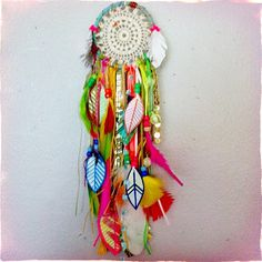 Wild and colorful little custom-order #dreamcatcher with hand painted feathers