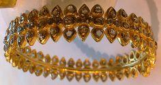 Jewellery Designs: Uncut diamonds bangle sets