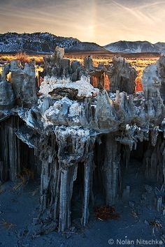 """The incredibly delicate sand tufa on the shores of Mono Lake. These structures can crumple as easily as a sand castle. It is a wonder that they are still standing. I believe the rainbow in this photo is called a ""sundog."""""