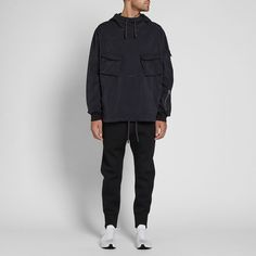Masters of innovative menswear apparel, Stone Island's Shadow Project collection present this Garment Dyed Duel Jersey Knit Smock. Cut from a polyester mix, this tonal piece is kitted out with multiple pockets and boasts this brands signature detachable compass patch to the sleeve. Ribbed cuffs and adjustable drawstrings to the hood and hemline ensure an optimal fit with every wear. Polyester Mix Garment Dyed Multiple Pockets Drawstring Adjustable Hood & Waistband Detachable Compass Patch...