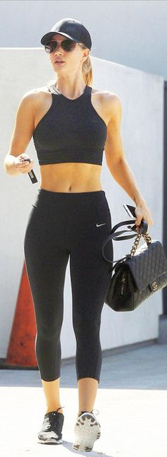 Who made  Rosie Huntington-Whiteley's black hat, sneakers, capri pants, crop, top, quilted handbag, and sunglasses?