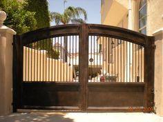 "Photo of Benitez Wrought Iron, Inc. - ""Custom wrought iron driveway gate"" - Sylmar, CA Wrought Iron Driveway Gates, Driveway Entrance, Front Gates, Entrance Gates, Fence Gate Design, Iron Gate Design, Tor Design, Custom Gates, Grades"