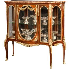 A Fine French Transitional Vitrine Cabinet In the Manner of François Linke | From a unique collection of antique and modern cabinets at https://www.1stdibs.com/furniture/storage-case-pieces/cabinets/