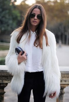 A white fur coat and black slim trousers are a combination that every stylish girl should have in her wardrobe.  Shop this look for $86:  http://lookastic.com/women/looks/dress-shirt-clutch-fur-coat-skinny-pants-sunglasses/4899  — White Silk Dress Shirt  — Black Leather Clutch  — White Fur Coat  — Black Skinny Pants  — Black Sunglasses