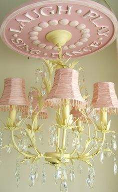 Ceiling Medallion for kids rooms by Marie Ricci. Shown in pink distressed with custom yellow chandelier.
