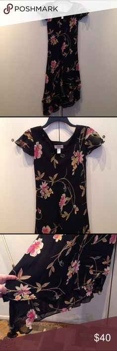 Talbots Floral Dress Beautiful and gently used dress. High to low on one side to the other. Cap sleeve with sheer shoulder coverage. May need to be cleaned. There are two dust spots (not stains) pictured. Talbots Dresses Asymmetrical