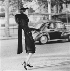 1920's Chanel coat | Woman modeling Balenciaga coat and dress. This ensemble smartly ...