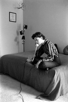 Natalie Wood takes a call while sitting on her bed at home in 1956. Photo by Ralph Crane.