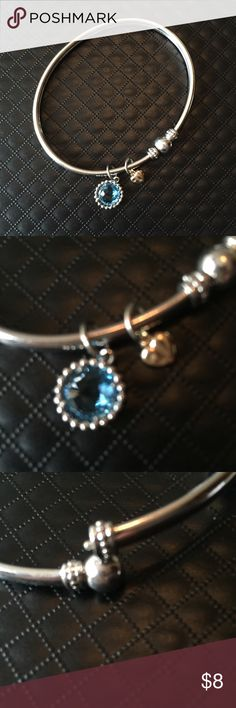 Silver bangle bracelet with charms Silver bangle bracelet with round blue charm and small heart. Clasp is hidden in round closure Jewelry Bracelets
