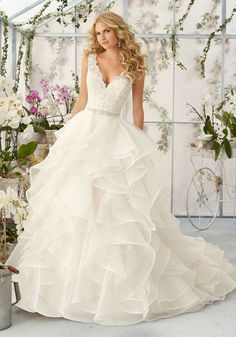 Wedding Dresses and Bridal Gowns by Morilee designed by Madeline Gardner. Venice Lace Appliques with Beading onto the Flounced Organza Skirt Wedding Dress