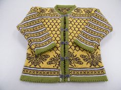 """The most amazing bee sweater ever - pattern from """"The New Stranded Colorwork: Techniques and Patterns for Vibrant Knitwear"""" by Mary Scott Huff."""