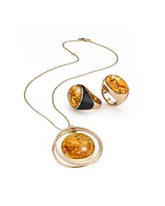 House of Amber - Exquisite amber rings from our Enlightened Enamel Collection and a stunning 18 carat white gold necklace with brilliants from our Bond of Orbit Collection by Antonello Cocuzza.