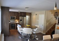 Our clients loved their north Winnipeg home – but the kitchen needed an overhaul. Learn how home renovation team made the homeowners fall in love again Kitchen Renovations, Home Renovation, Forest Park, Construction, Table, Furniture, Home Decor, Building, Decoration Home
