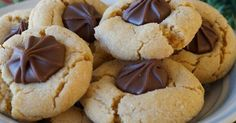 Chocolate and peanut butter marry beautifully in this soft cookie. This is a recipe my mom has used for years and always uses chocolate st...