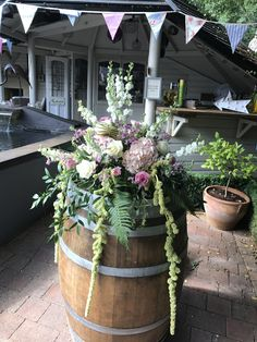 Flower arrangement on a large Beer Barrel super at any party or wedding.
