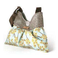 Flowering Pyrus handbag in Cornflower blue. Handmade from 90% recycled materials.