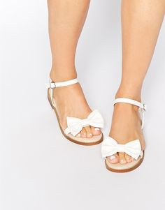 Hooked by the whimsy of these sandals ............but I never wear white shoes. These would be great in almost any other color.